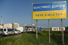 Hrushiv, Ukraine - May 31, 2017: Sign `Have a nice trip. ` in Hrushiv-Budomezh checkpoint on the border with Ukraine and Poland some 60kms from city of Lviv Royalty Free Stock Images