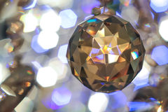 Hrustal stone on the background bokeh. Festive elegant abstract background with bokeh lights Royalty Free Stock Image