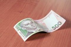 Hryvna ucraniano del dinero en fondo de madera Imágenes de archivo libres de regalías