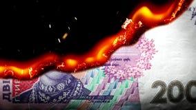 Hryvnia bill Ukrainian money burning in flames stock video