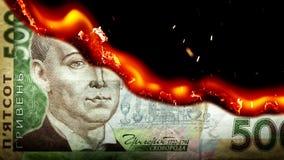 Hryvnia bill Ukrainian money burning in flames stock video footage