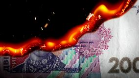 Hryvnia bill Ukrainian money burning in flames. Economic crisis or inflation concept. UHD stock footage