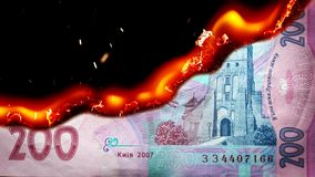Hryvnia bill Ukrainian money burning in flames. Economic crisis or inflation concept. UHD stock video footage