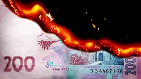 Hryvnia bill Ukrainian money burning in flames. Economic crisis or inflation concept. UHD stock video