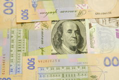 Hryvnia. The denomination of one hundred dollars is surrounded by denominations of five hundred hryvnias