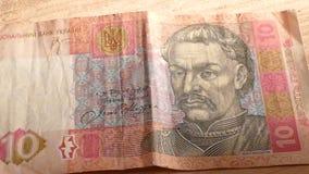 Hryvnia ucraniano e o dólar americano vídeos de arquivo