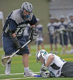 HS Lacrosse goalie recovers Royalty Free Stock Images