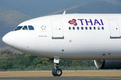 HS-TAT  Airbus A300-600 of Thaiairway Taxi on Chiangmai airport Stock Photography
