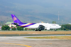 HS-TAT  Airbus A300-600 of Thaiairway Taxi on Chiangmai airport Royalty Free Stock Photography