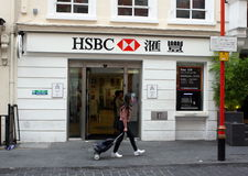 HSBC Bank. London, England - Sept 4th, 2014: A pedestrian passes by the front entrance of the Gerrard Street branch of HSBC Bank in London's Chinatown Royalty Free Stock Image