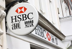 HSBC Bank Sign. In English and Chinese chracters above the front entrance in Gerrard Street, London, England stock image