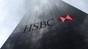 HSBC-embleem op een wolkenkrabbervoorgevel die op wolken wijzen Het redactie 3D teruggeven Stock Fotografie