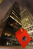 HSBC and the Red Cube. HSBC building in New York City at night with Isamu Noguchi's Cube on the sidewalk in front Royalty Free Stock Photo