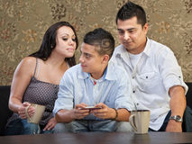 Hsiapanic Parents Watching Son. Clever Hispanic teenager watching parents watch his text messaging Stock Photos