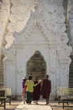 Hsinbyume Pagoda - Mingun - Myanmar (Burma). Buddhist monks and local women entering the Hsinbyume or Myatheindan Pagoda at Mingun near Mandalay in Myanmar ( Stock Image