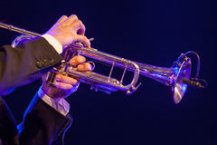 Hsnds playing trumpet Stock Images