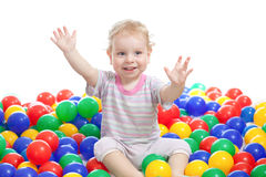 Hsppy boy playing colorful balls Stock Photos