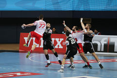 HT de Besiktas MOGAZ et match de handball de Dinamo Bucuresti Photographie stock libre de droits