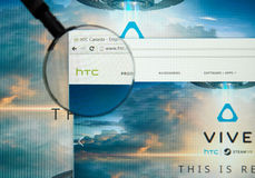HTC internet page. MONTREAL, CANADA - MARCH 25, 2016 - HTC internet page under magnifying glass. HTC Corporation is a Taiwanese multinational manufacturer of Stock Image