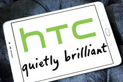 Htc logo. Logo of mobile company htc on samsung tablet Stock Photos