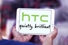 Htc logo. Logo of mobile company htc on samsung tablet in hands Royalty Free Stock Image