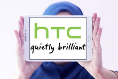 Htc logo. Logo of mobile company htc on samsung tablet holded by arab muslim woman Royalty Free Stock Images