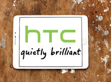 Htc logo. Logo of mobile company htc on samsung tablet on wooden background Stock Images