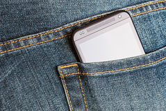 HTC Mobile Phone in a jeans pocket. Moscow, Russia - March 18, 2014: HTC Mobile Phone in a jeans pocket. HTC Corporation founded in 1997 by Cher Wang, HT Cho and Royalty Free Stock Images