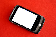 HTC Smartphone. With white display on a red texture - copy space Stock Photos