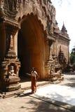 Htilominlo Pahto in Bagan. The Burmese woman stood at the gate of the Htilominlo Pahto which is youngest buddhist stupas in the Bagan, Myanmar royalty free stock image