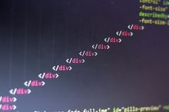 HTML code. Computer programming source code. Abstract screen of web developer. Digital technology modern background. Shallow depth. Of field. Code is created by Royalty Free Stock Image