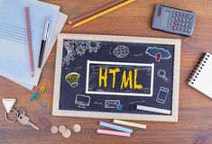 HTML Homepage Domain Web Design Concept. Chalkboard on wooden of. Fice desk Royalty Free Stock Photos