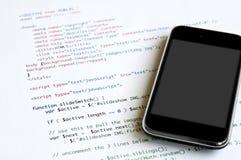 HTML och smartphone royaltyfri foto