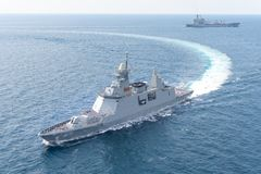 HTMS Bhumibol Adulyadej stealth frigate of Royal Thai Navy sails along with USNS Guadalupe underway replenishment oiler. ANDAMAN SEA, THAILAND - APRIL 9, 2019 stock photography