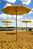 HTO Park Beach. Toronto – Canada. The park's standout feature is a sandpit that holds Muskoka chairs and enormous fixed yellow metal umbrellas Stock Photos