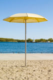 HTO Park Beach. Toronto, Canada. The park's standout feature is a sandpit that holds Muskoka chairs and enormous fixed yellow metal umbrellas Stock Photo