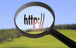Http address bar. Magnifying glass with the word http address bar on blurred nature background. Searching http address bar concept Stock Photography