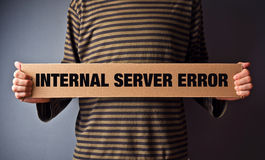 Http Error 500, Server error page concept. Man holding banner with error message. Web technolgy series royalty free stock photography