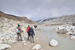 Hikers looking at the road ahead of Everest Base Camp trek while continuing to conquer the mountain, Nepal