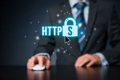 HTTPS concept. HTTPS - secured internet concept. Businessman or programmer click on https text and padlock symbol stock images