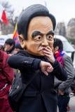Hu Jin Tao Caricature. Someone wearing a big mask showing Hu Jin Tao's face, to denounce China's policy in Tibet Royalty Free Stock Photo