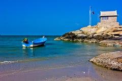 Hua hin beach. The green sea, the sky is blue, the fishing boat Stock Photography