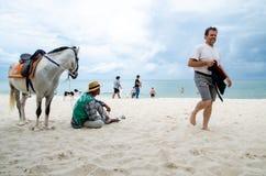 Hua Hin Beach, Thailand. Horse and owner wait for tourists on the Hua Hin Beach, Thailand Stock Photo