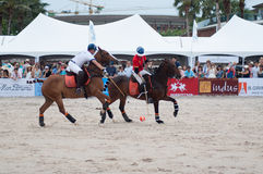 HUA HIN, THAILAND - APRIL 25: India Polo Team (white-red) plays against  Thailand Polo Team (white) during 2015  Beach Polo Asia C. HUA HIN, THAILAND - APRIL 25 Royalty Free Stock Images