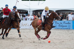 HUA HIN, THAILAND - APRIL 25: India Polo Team (white-red) plays against  Thailand Polo Team (white) during 2015  Beach Polo Asia C. HUA HIN, THAILAND - APRIL 25 Royalty Free Stock Photo