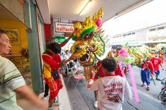 Hua Hin,Thailand -February 18, 2015: Thai people celebration Chinese new year  with a parade led by a dragon in Hua Hin. Royalty Free Stock Images