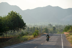 Riding in the Thai countryside Stock Images