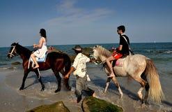 Hua Hin, Thailand: Riding Horses on the Beach Royalty Free Stock Photography