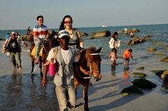 Hua Hin, Thailand: Riding Horses on the Beach Royalty Free Stock Images