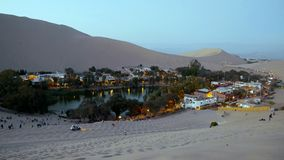 Huacachina - The Extraordinary Desert Oasis in Peru - dune buggy and sand boarding tour. stock images